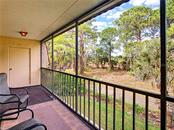 Screened lanai with storage closet - Condo for sale at 211 Rubens Dr #h, Nokomis, FL 34275 - MLS Number is N6103629