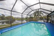 Pool Overlooking Lake and Patio - Single Family Home for sale at 41 Caroll Cir, Englewood, FL 34223 - MLS Number is N6104860