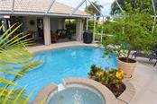 Pool, lanai - Single Family Home for sale at 537 Lake Of The Woods Dr, Venice, FL 34293 - MLS Number is N6106043