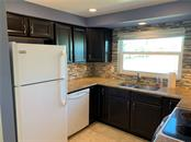 Espresso cabinets, under mount lighting, newer appliances, 70/30 ss sink with newer disposal, glass top stove - Single Family Home for sale at 1656 La Gorce Dr, Venice, FL 34293 - MLS Number is N6107911
