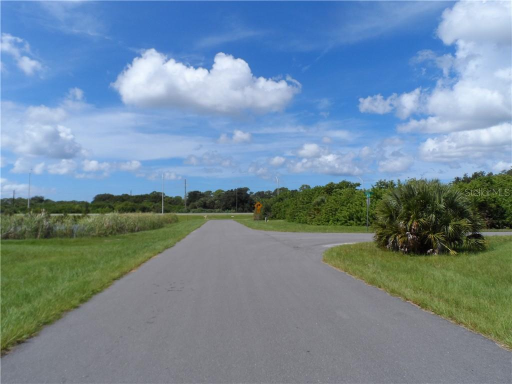 View from the front of the lot looking west on Rifle - Vacant Land for sale at 119 Rifle Rd, Rotonda West, FL 33947 - MLS Number is C7406393