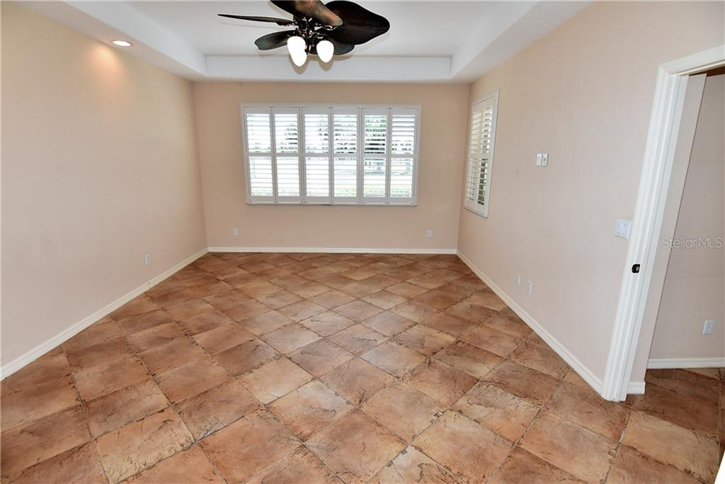 Master bedroom with tray ceiling and windows to rear and lanai - Condo for sale at 3959 San Rocco Dr #212, Punta Gorda, FL 33950 - MLS Number is C7409637