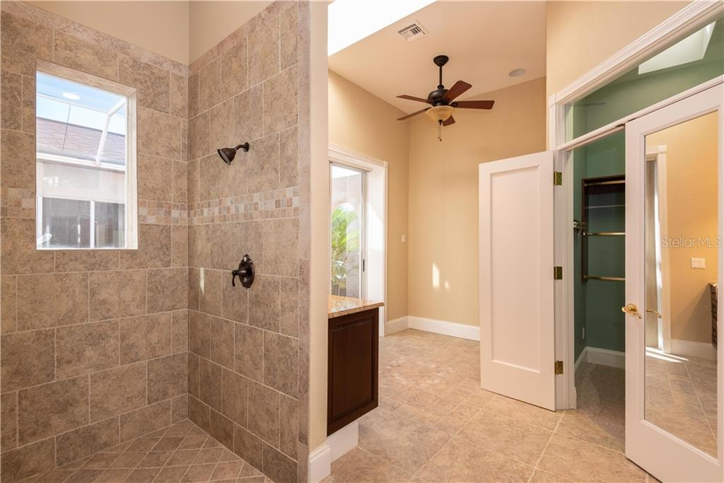 HIS MASTER BATH - Single Family Home for sale at 13000 Windcrest Dr, Port Charlotte, FL 33953 - MLS Number is C7410459