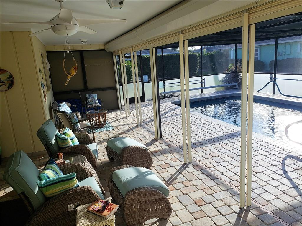 Plenty of room to relax on your covered pool deck - Single Family Home for sale at 24 Tiffany St, Englewood, FL 34223 - MLS Number is C7410842