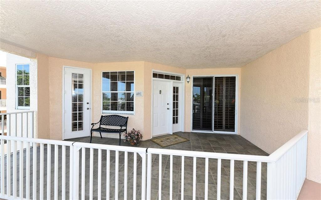 Front entry porch - Condo for sale at 1260 Dolphin Bay Way #401, Sarasota, FL 34242 - MLS Number is A4173008