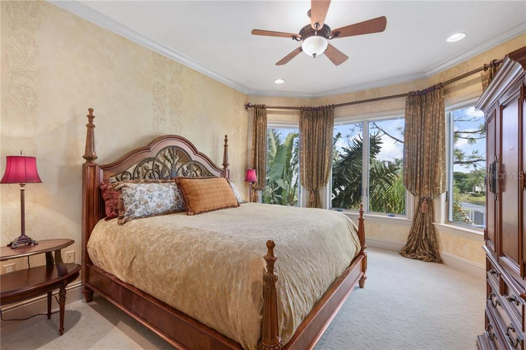 One of three guest bedroom suites. - Single Family Home for sale at 7320 Barclay Ct, University Park, FL 34201 - MLS Number is A4200908