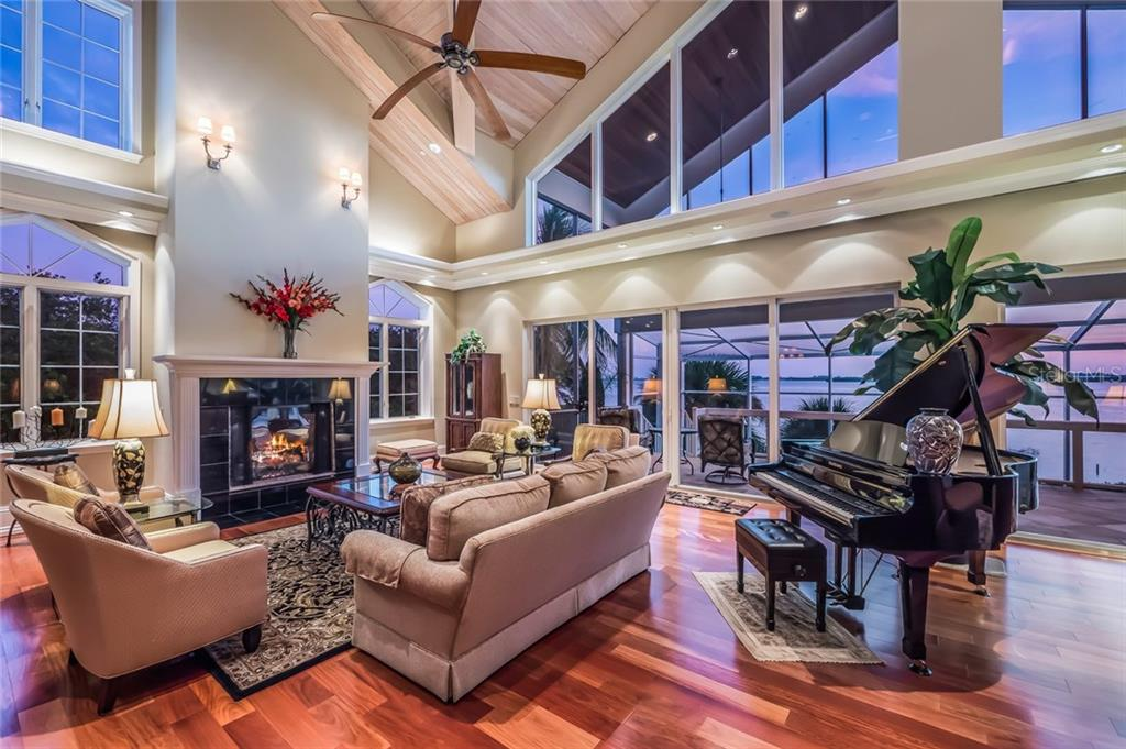 Living/Great Room Dual Gas Fireplaces - Single Family Home for sale at 39 Tidy Island Blvd, Bradenton, FL 34210 - MLS Number is A4202735