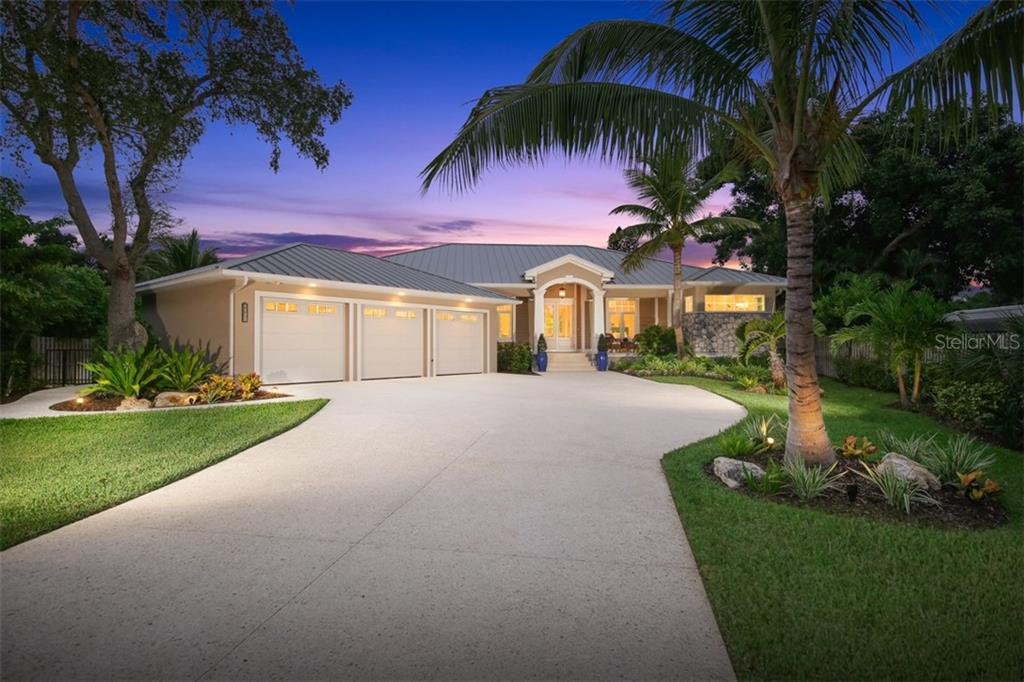 Front of House at Dusk - Single Family Home for sale at 4847 Primrose Path, Sarasota, FL 34242 - MLS Number is A4415116
