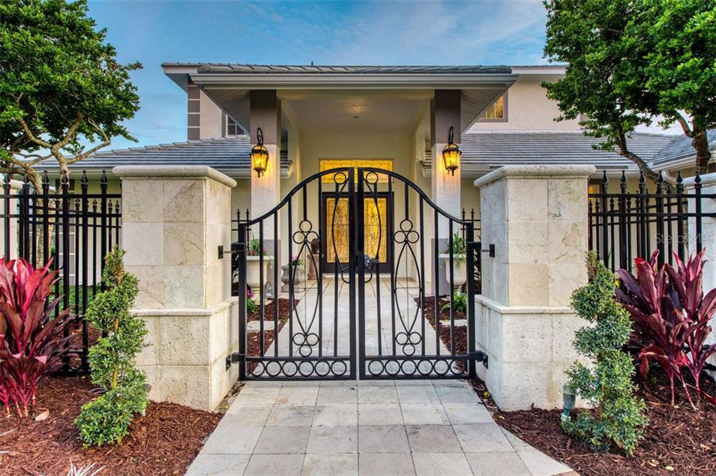 Dramatic entry to courtyard. - Single Family Home for sale at 7689 Cove Ter, Sarasota, FL 34231 - MLS Number is A4417242