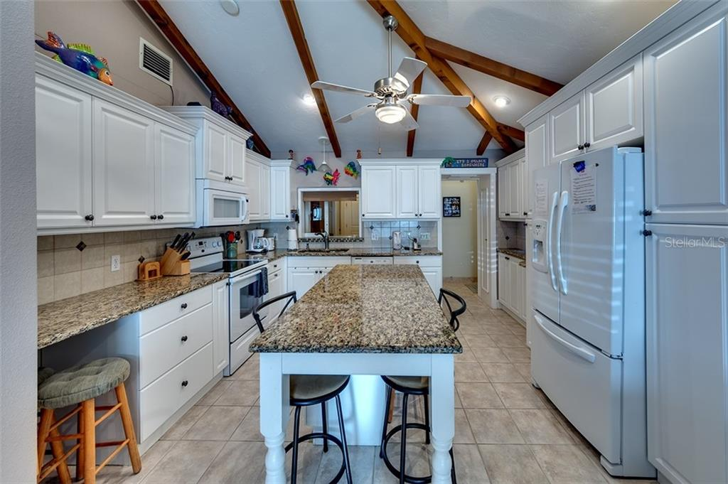 Single Family Home for sale at 114 Elm Ave, Anna Maria, FL 34216 - MLS Number is A4420296