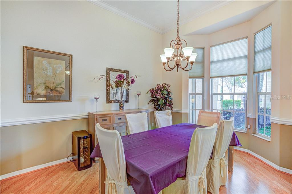 Large remodeled bay window dining room - Single Family Home for sale at 6321 W Glen Abbey Ln E, Bradenton, FL 34202 - MLS Number is A4429610
