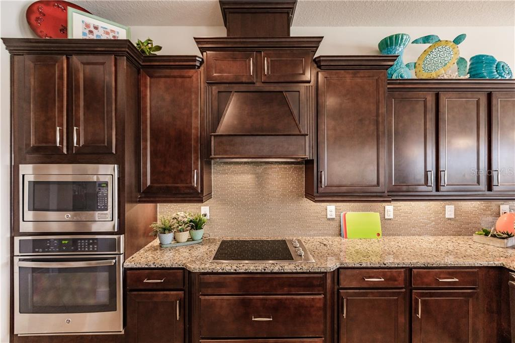 Range hood vents to the outside. - Single Family Home for sale at 17006 1st Dr E, Bradenton, FL 34212 - MLS Number is A4432830
