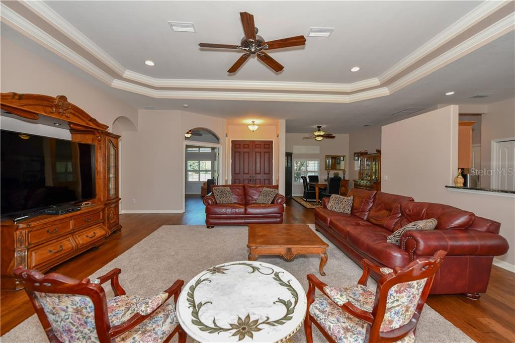 Great room open to Kitchen - Single Family Home for sale at 2745 Harvest Dr, Sarasota, FL 34240 - MLS Number is A4436381