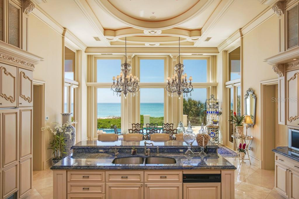 Eating space in the kitchen overlooking the Gulf of Mexico - Single Family Home for sale at 845 Longboat Club Rd, Longboat Key, FL 34228 - MLS Number is A4440615