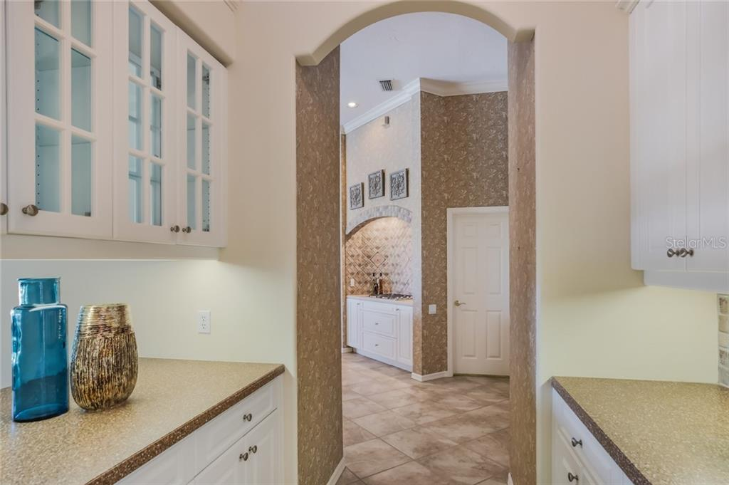 ALL Wall Paper now removed and freshly painted! - Single Family Home for sale at 8208 Championship Ct, Lakewood Ranch, FL 34202 - MLS Number is A4441026
