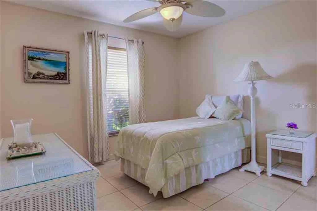 Light, bright 3rd Bedroom with Tiled Flooring and oversized window.  Love the neutral colors in this room- - Single Family Home for sale at 5109 76th St E, Bradenton, FL 34203 - MLS Number is A4443335
