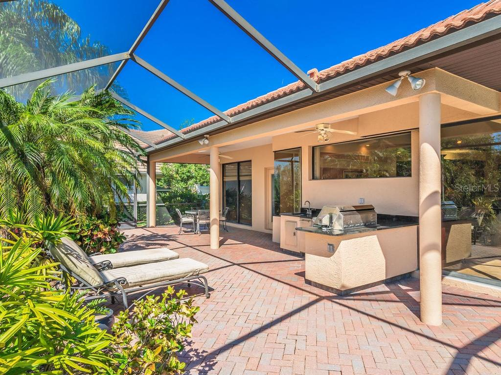 Extended lanai view - Single Family Home for sale at 6826 Turnberry Isle Ct, Lakewood Ranch, FL 34202 - MLS Number is A4450601