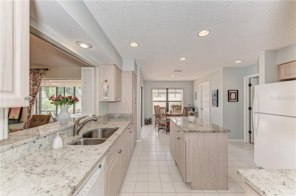 Updated kitchen with granite countertops and island - Single Family Home for sale at 2980 Heather Bow, Sarasota, FL 34235 - MLS Number is A4450964