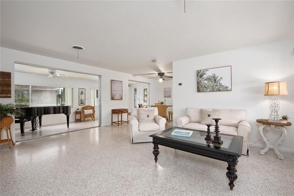 The very large, maintenance free side yard could be the perfect place to put a pool and the door in the carport goes straight to what could be the pool bathroom! - Single Family Home for sale at 691 Tarawitt Dr, Longboat Key, FL 34228 - MLS Number is A4451584