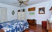 Guest room. - Single Family Home for sale at 465 E Royal Flamingo Dr, Sarasota, FL 34236 - MLS Number is A4187554