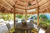 Tropical oasis - entertain in style from the tiki hut and lagoon pool. - Single Family Home for sale at 306 Gulf Blvd, Anna Maria, FL 34216 - MLS Number is A4206962