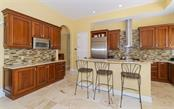 Kitchen with breakfast counter - Single Family Home for sale at 1179 Morningside Pl, Sarasota, FL 34236 - MLS Number is A4209174