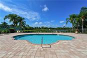 Community pool overlooking lake - Single Family Home for sale at 2745 Harvest Dr, Sarasota, FL 34240 - MLS Number is A4436381