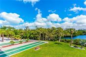 Shuffleboard by the Lagoon - Condo for sale at 20 Whispering Sands Dr #102 & 103, Sarasota, FL 34242 - MLS Number is A4441587