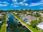 Beach to Bay living - Single Family Home for sale at 560 Wedge Ln, Longboat Key, FL 34228 - MLS Number is A4452288