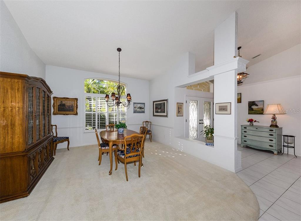 Dining room, foyer - Single Family Home for sale at 515 Park Estates Sq, Venice, FL 34293 - MLS Number is N6103193