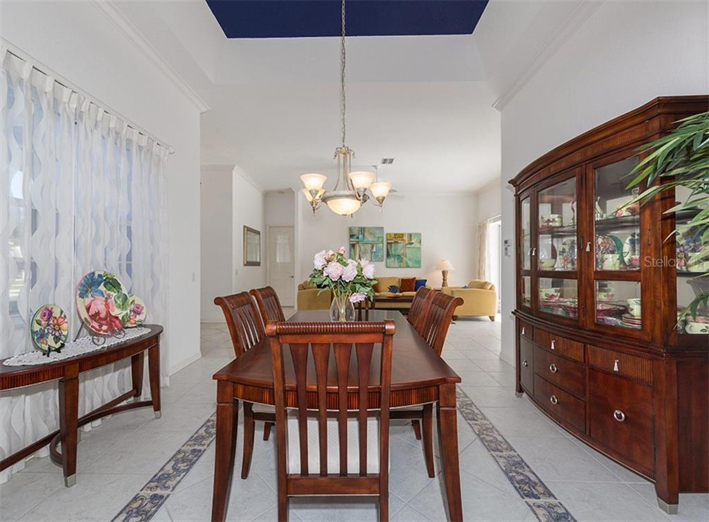 Dining room to living room - Single Family Home for sale at 2201 Sonoma Dr E, Nokomis, FL 34275 - MLS Number is N6103410