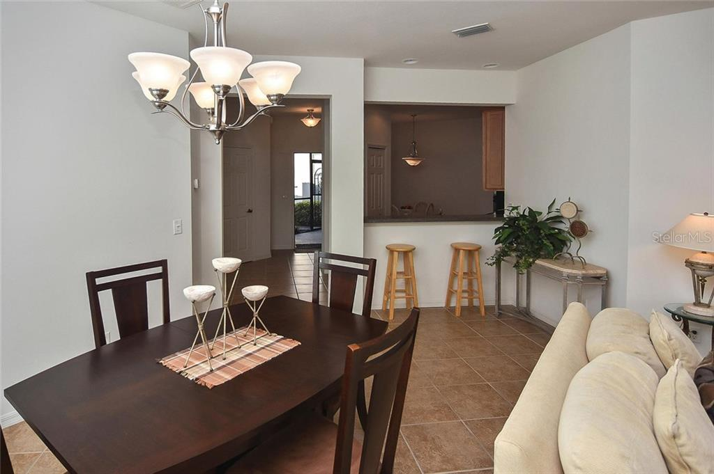 Dining room to kitchen and foyer - Villa for sale at 11108 Batello Dr, Venice, FL 34292 - MLS Number is N6104651