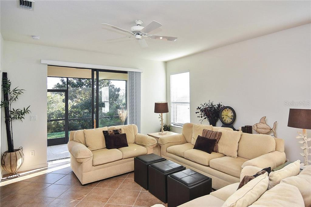 Living room with sliders to lanai - Villa for sale at 11108 Batello Dr, Venice, FL 34292 - MLS Number is N6104651