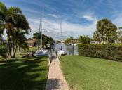 Stroll to finger dock with concrete sea wall - Single Family Home for sale at 1980 W Marion Ave, Punta Gorda, FL 33950 - MLS Number is N6104995